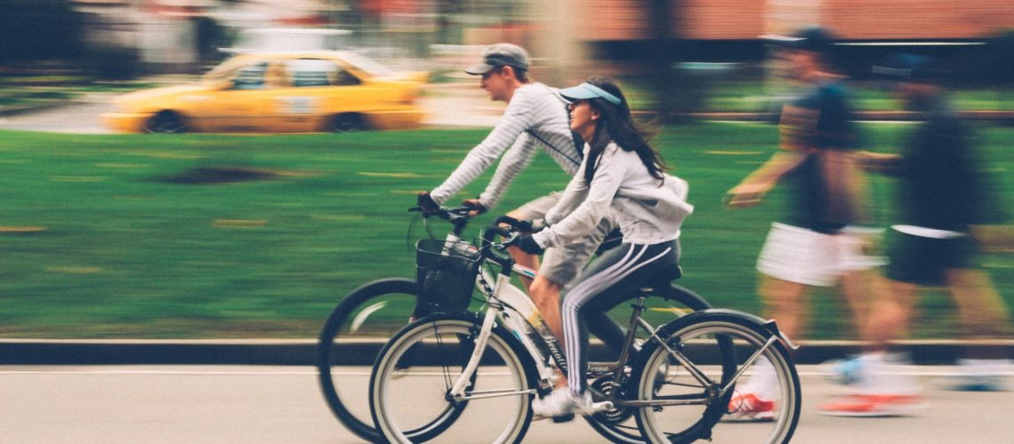 Couple cycling on the road